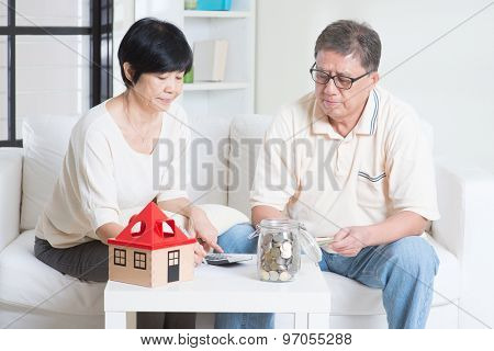 Asian senior couple counting on money. Saving, retirement plan, retirees financial planning concept. Family living lifestyle at home.
