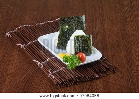 Japanese Cuisine. Onigiri Or Rice On The Background