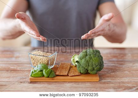 healthy eating, diet and people concept - close up of male hands showing food rich in fiber