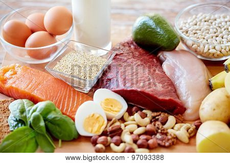 balanced diet, cooking, culinary and food concept - close up of different foodstuffs on table