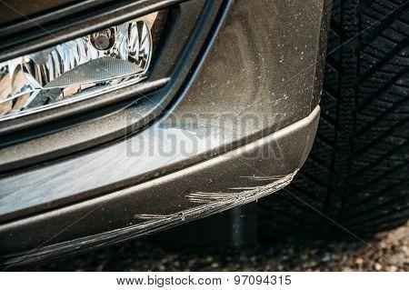 Black Bumper Car Scratched, Deep Damage To Paint.