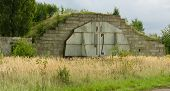 Abandoned soviet military aircraft hangar and bunker poster