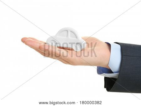 Insurance concept. Male hand holding toy car on white background