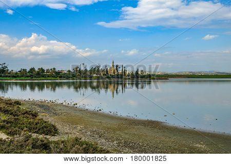 Aliki salt lake looking toward the Hala Sultan Tekke Mosque in Larnaka, Cyprus.