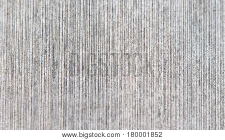 Regular wood texture with vertical lines. Subtle grey wooden background for natural banner. Timber surface closeup. Vertical wood ornament of floor backdrop photo. Natural material for banner template