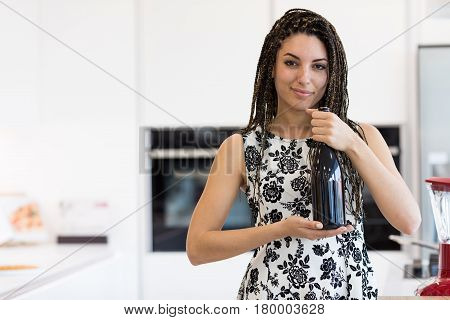 Pretty Woman With Bottle Of Vine