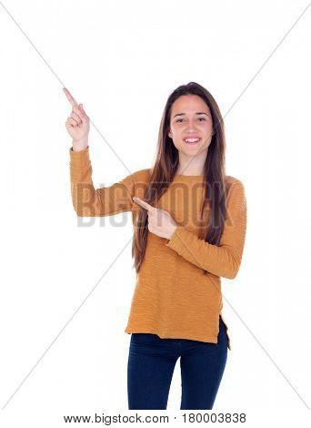 Teenager girl of sixteen years old indicating something isolated on a white background