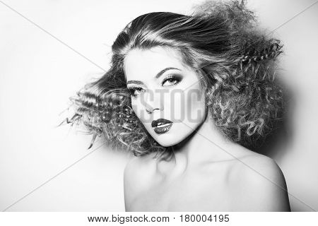 Beauty young woman with curly big and long hair. Permed hair. Glamour lady, Beautiful Woman Portrait. redhead Wavy Hair, perfect make up, red lips, thick eyelashes.