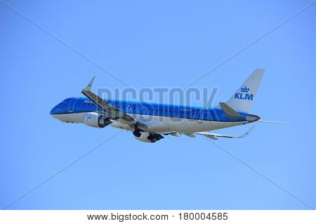 Amsterdam the Netherlands - April 2nd 2017: PH-EXE KLM Cityhopper Embraer ERJ-190STD takeoff from Polderbaan runway Amsterdam Airport Schiphol