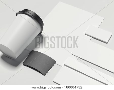 Cardboard coffee cup and branding mockup isolated on white. 3d rendering