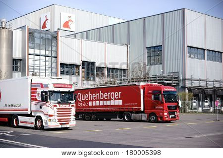 MAINZ, GERMANY - MARCH 24: Trucks parked in front of the entrance to the headquarter of the shoe care products producer Erdal of the company Werner and Mertz on March 24, 2017 in Mainz.