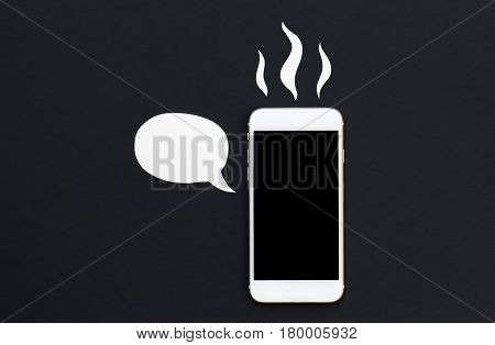 White phone with cartoon text bubble and hot smoke. Smartphone in paper cut collage. Creative cellphone banner template with text place. Broken phone. Hot news or message