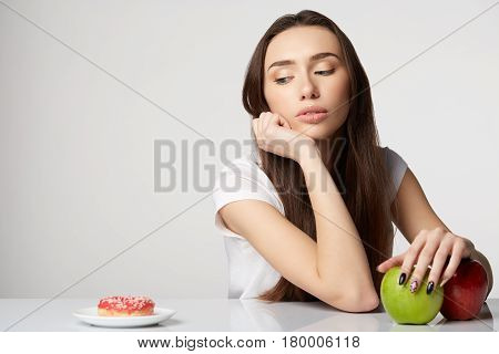 woman girl with fruits basket on gray white background smile happy health care healthy gray closeup beauty apples green red donut