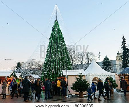 People At Decorated Christmas Tree And Souvenir Houses In Vilnius