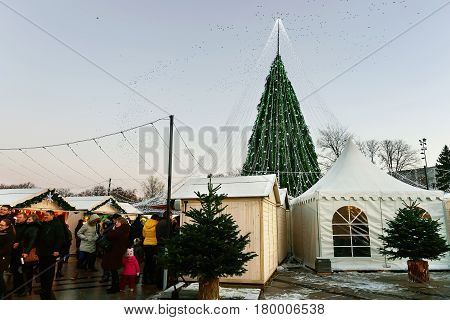 People At Decorated Christmas Tree And Souvenir Market In Vilnius