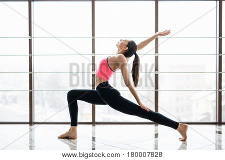 Urdhva Virabhardasana Woman Practicing Advanced Yoga In Studio Room