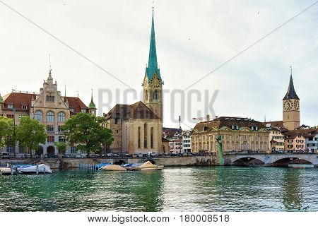 Fraumunster Church And Saint Peter And Boats At Limmat Zurich