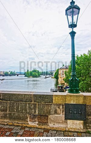 Lantern At Charles Bridge Over Vltava River In Prague