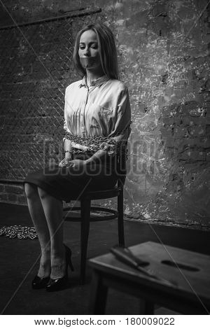 My key to freedom. Anxious restless young woman looking at the knife lying on the table and coming up with a plan of her rescue