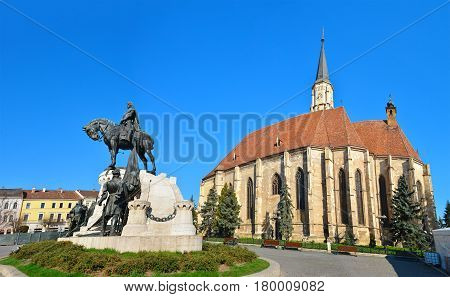 Cluj Napoca city Romania Statue of Matei Corvin and Saint Michael's Church