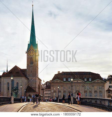 People On Munsterbrucke Bridge In Fraumunster Church In Zurich