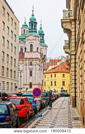 Street With St Nicholas Church In Lesser Town Square Prague