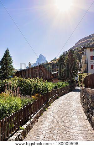 Traditional Swiss Chalets At Zermatt With Matterhorn Summit