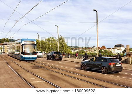 Tram And Cars On Limmatquai In City Center Of Zurich