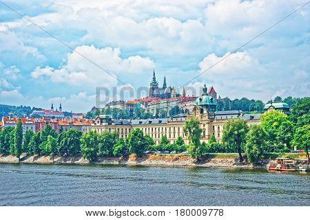Vltava River Embankment With Prague Old Town With Strakova Academy