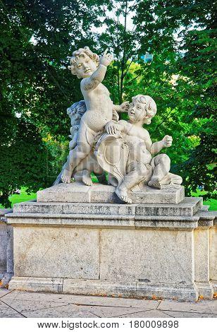 Angel Putti Statue In Burggarten Park In Vienna