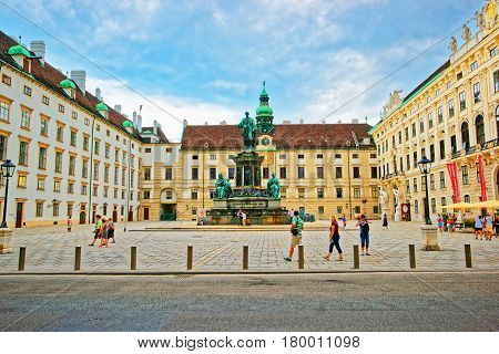 Tourists At Amalienburg And Inner Courtyard In Vienna