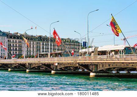 Mont Blanc Bridge With Swiss Flags Over Geneva Lake