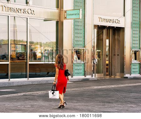Woman In Red Dress Going To Tiffany Shop In Geneva