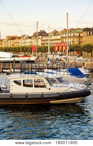 Boats In Geneva Lake Near Promenade Du Lac