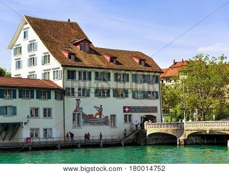 Historical Building With Painting At Limmat River Quay In Zurich