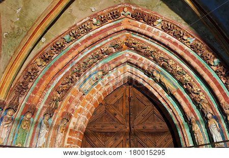 Malbork, Poland - May 8 2014: Painting at entrance door in Malbork Castle also called as Marienburg Teutonic Order Poland.