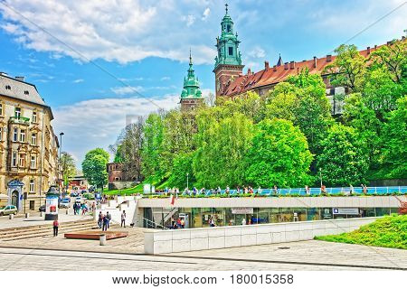 People At Krakow City Center With Wawel Castle