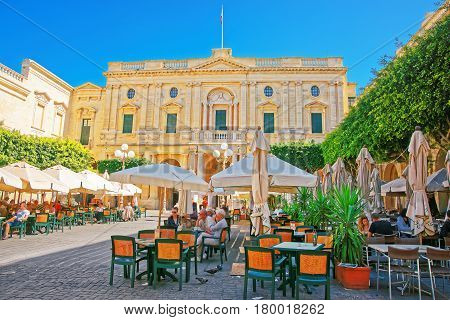 People Resting At Open Air Cafes At Republic Square Valletta