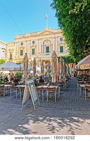 People Resting In Open Air Cafes On Republic Square Valletta