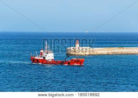 Dry Cargo Vessel At Breakwater At Fort Ricasoli Of Kalkara