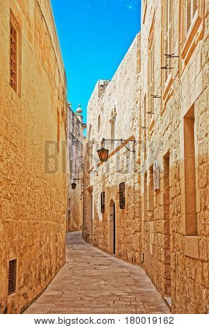 Narrow Silent Street With Lamp In Mdina