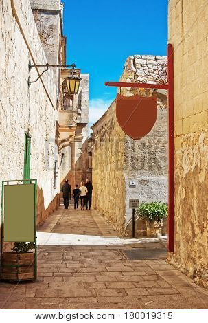 People At Narrow Silent Street With Lantern In Mdina