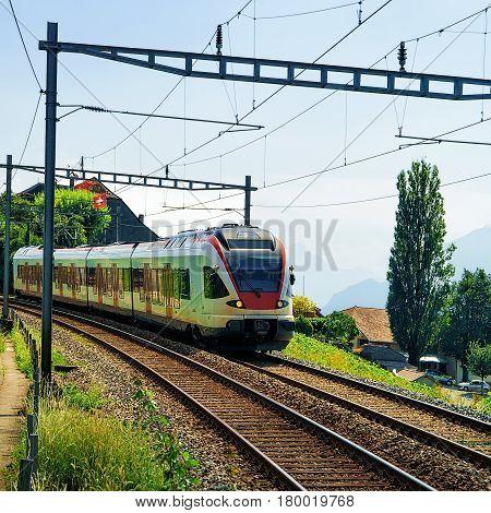 Running Train At Vineyard Terraces Of Lavaux Switzerland