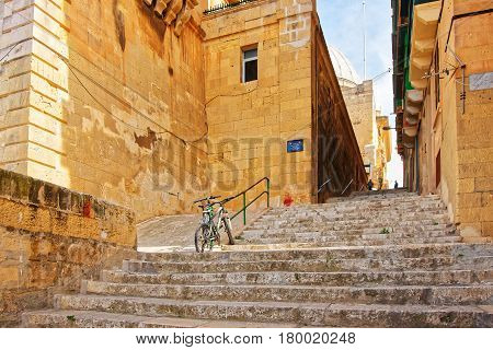 Street With Staircase At Old City Center In Valletta
