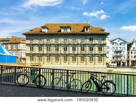 Bicycles At Old Town Hall In River Limmat In Zurich