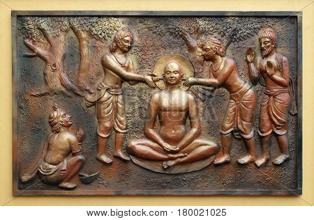 KOLKATA,INDIA - FEBRUARY 09: The pegs are being extracted with the help incers, Street bass relief on the wall of Jain Temple (also called Parshwanath Temple) in Kolkata, India on February 09,2016.