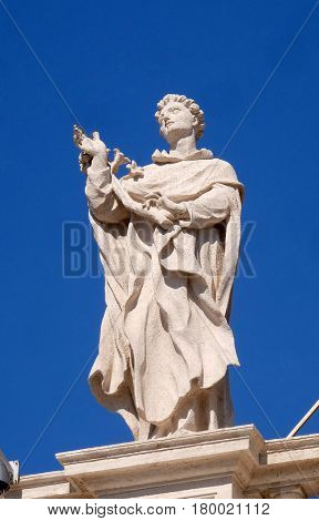 ROME, ITALY - SEPTEMBER 02: St. Albert, fragment of colonnade of St. Peters Basilica - the world largest church, is the center of Christianity in Rome, Italy on September 02, 2016.