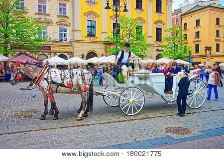 Horse Fiacre And People In Old Town Of Krakow