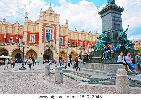 People At Adam Mickiewicz And Cloth Hall In Main Square