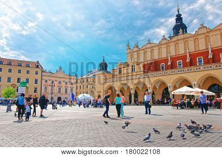 People At Cloth Hall At Main Market Square In Krakow